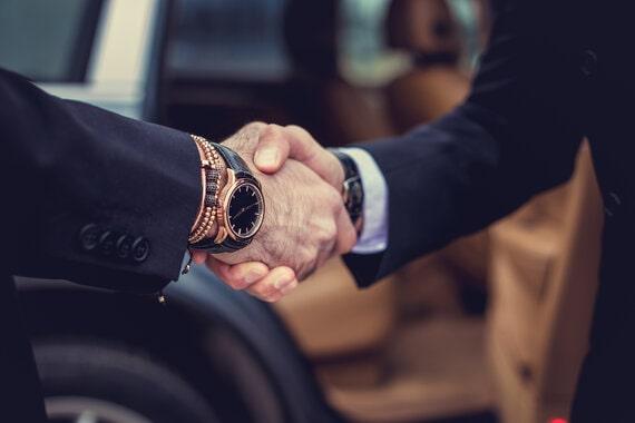 [object object] Financial Partners rsz two men handshake rvtlmsb min